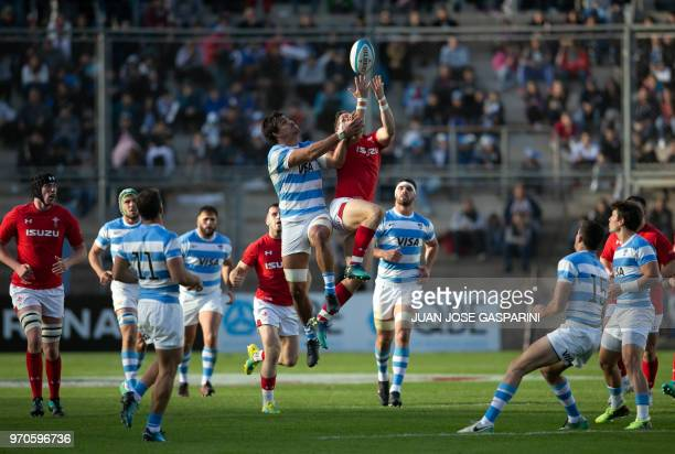 Hallam Amos of Wales jumps for the ball during an International Test Match between Argentina and Wales at the San Juan del Bicentenario Stadium on...
