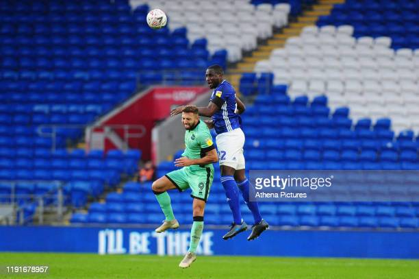 Hallam Hope of Carlisle United under pressure from Sol Bamba of Cardiff City during the FA Cup third round match between Cardiff City and Carlisle...
