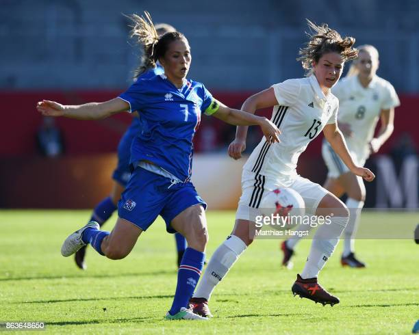 Hallbera Guony Gisladottir of Iceland and Melanie Leupolz of Germany compete for the ball during the 2019 FIFA Women's World Championship Qualifier...