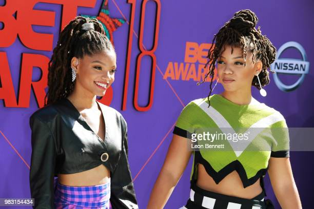 Halle Bailey and Chloe Bailey of Chloe X Halle attend the 2018 BET Awards at Microsoft Theater on June 24 2018 in Los Angeles California