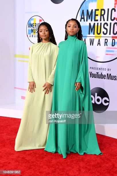 Halle Bailey and Chloe Bailey of Chloe x Halle attend the 2018 American Music Awards at Microsoft Theater on October 9 2018 in Los Angeles California