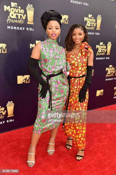 Halle Bailey and Chloe Bailey of RB duo Chloe X Halle attend the 2018 MTV Movie And TV Awards at Barker Hangar on June 16 2018 in Santa Monica...