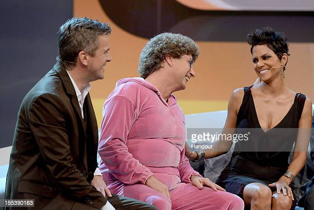 Halle Barry Markus Lanz and Atze Schroeder look on during the 'Wetten dass' show on November 3 2012 in Bremen Germany