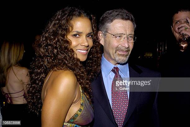 Halle Berry and Barry Meyer of Warner Bros during Catwoman Premiere After Party at Parking Lot of Archlight Cinema in Hollywood California United...