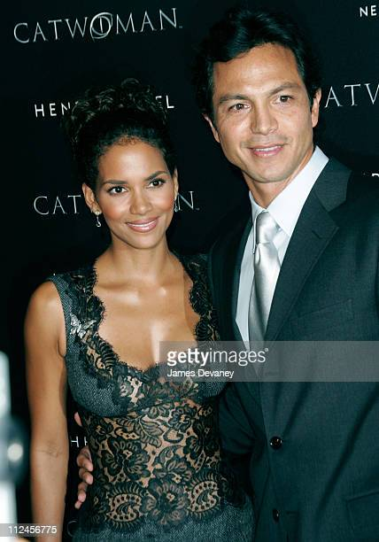 """Halle Berry and Benjamin Bratt during Warner Bros. Consumer Products and Henri Bendel Host Purr-fect """"Catwoman"""" at Henri Bendel in New York City, New..."""