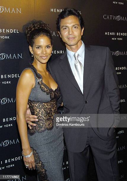 """Halle Berry and Benjamin Bratt during Warner Bros. Consumer Products and Henri Bendel Host Purr-fect """"Catwoman"""" - After Party at Henri Bendel in New..."""