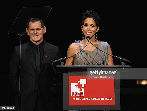 Halle Berry and CEO of Coty Inc Bernd Beet speak at the DKMS' 4th Annual Gala Linked Against Leukemia at Cipriani 42nd Street on April 29 2010 in New...