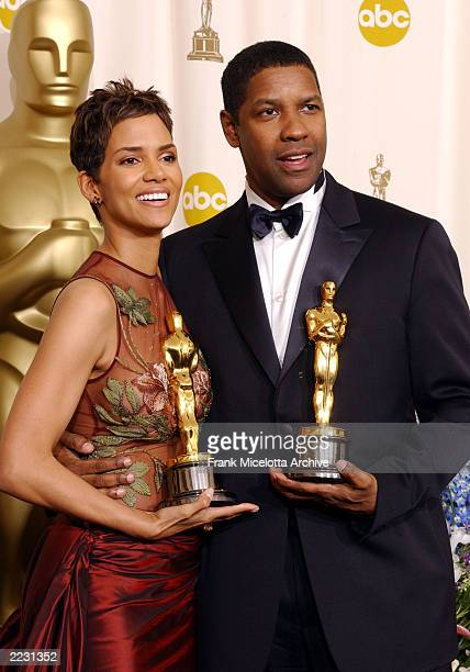 Halle Berry and Denzel Washington backstage at the 74th Annual Academy Awards held at the Kodak Theatre in Hollywood Ca March 24 2002 photo by Frank...