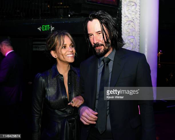 Halle Berry and Keanu Reeves pose at the after party for a special screening of LionsGate's John Wick Chapter 3 Parabellum at Avalon on May 15 2019...