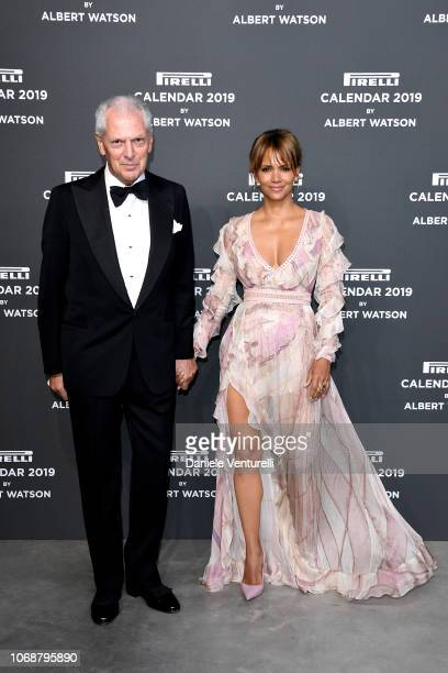 Halle Berry and Marco Tronchetti Provera walk the red carpet ahead of the 2019 Pirelli Calendar launch gala at HangarBicocca on December 5, 2018 in...