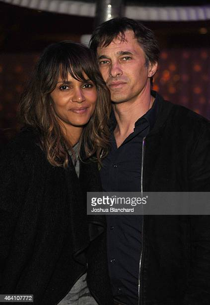 Halle Berry and Olivier Martinez attend the Treats Magazine PreOscar Party at the Treats Villa presented by OMNIA on February 21 2015 in Los Angeles...