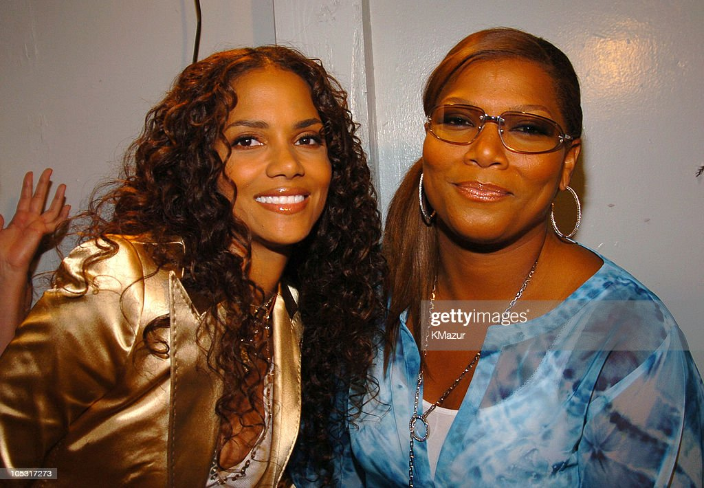 Halle Berry and Queen Latifah during MTV Movie Awards 2004 - Backstage and Audience at Sony Pictures Studios in Culver City, California, United States.