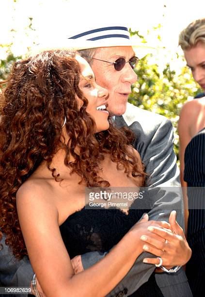 Halle Berry and Sir Ian McKellen during 2006 Cannes Film Festival XMen 3 The Last Stand Photocall at Palais des Festival Terrace in Cannes France