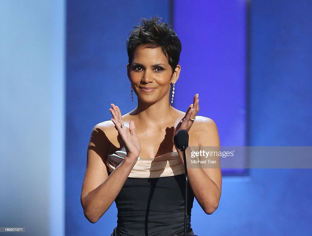 Halle Berry applauds on stage at the 44th NAACP Image Awards - show held at The Shrine Auditorium on February 1, 2013 in Los Angeles, California.