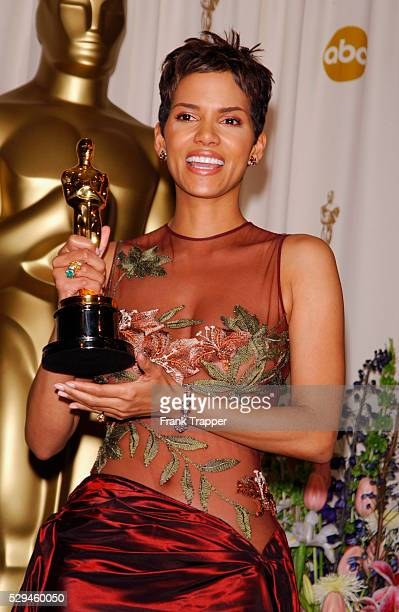 Halle Berry holding her Best Actress Oscar in the pressroom at the 74th annual Academy Awards