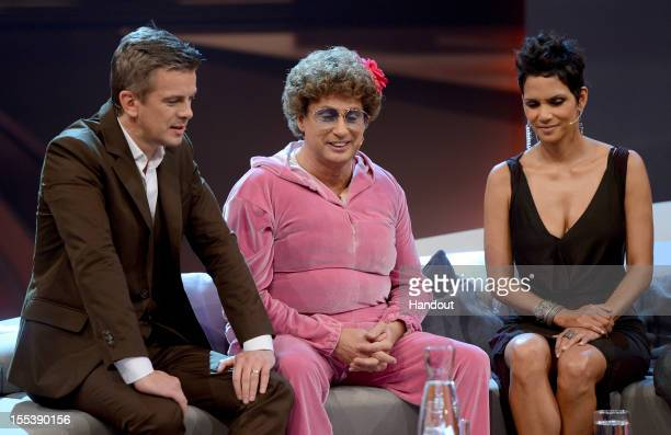 Halle Berry Markus Lanz and Atze Schroeder look on during the 'Wetten dass' show on November 3 2012 in Bremen Germany