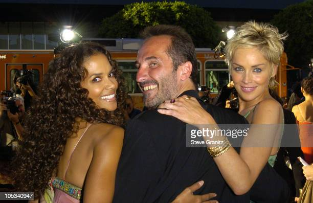 """Halle Berry, Pitof, director and Sharon Stone during """"Catwoman"""" World Premiere - Arrivals at Cinerama Dome in Hollywood, California, United States."""