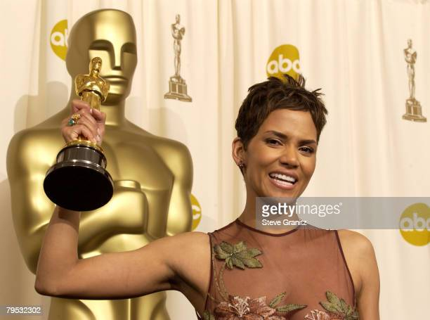 Halle Berry poses with her Actress in a Leading Role Oscar for Monster's Ball