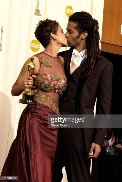 Halle Berry winner of the Actress in a Leading Role award and her husband Eric Benet