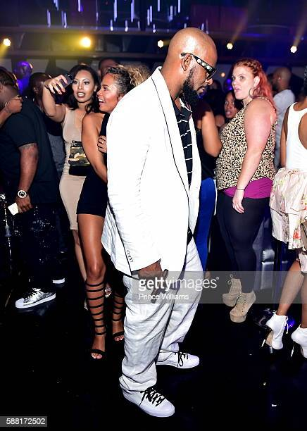 Halle Calhoun and R Kelly attend a Party at Gold Room on August 7 2016 in Atlanta Georgia
