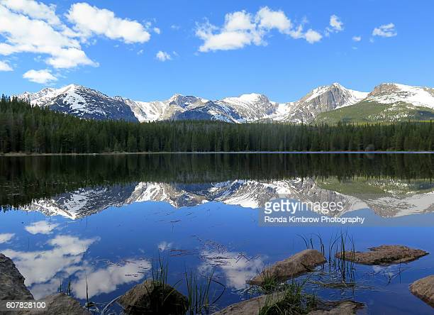 Hallett Peak and the Continental Divide reflect in the waters of Bierstadt Lake in Rocky Mountain National Park