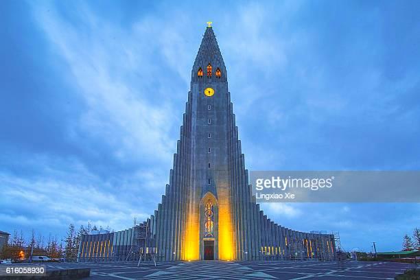 Hallgrimskirkja parish church illuminated at dusk, Reykjavik, Iceland