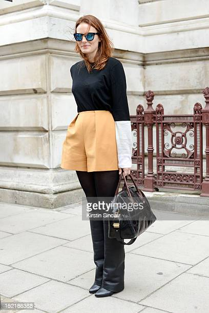 Hallie Chrisman, publicity director of KCD wearing Givenchy boots and bag, Carven shorts, Pringle top, Westwood leaning shades on day 3 of London...
