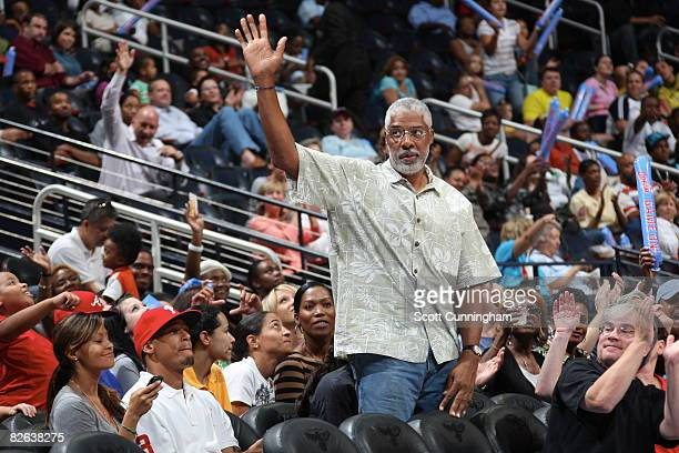 HallofFamer Julius Erving acknowledges the crowd during the game between the Atlanta Dream and the Seattle Storm at Philips Arena September 2 2008 in...
