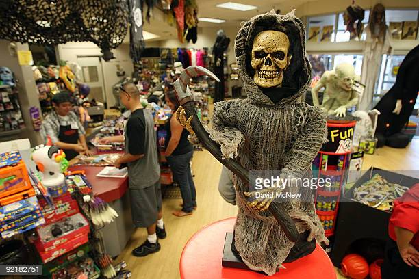 Halloween Adventure store located in a defunct Circuit City consumer electronics store building sells costumes props and accessories for Halloween...