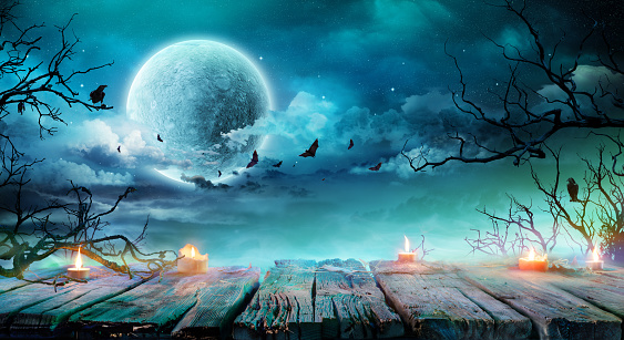 Halloween Background  - Old Table With Candles And Branches At Spooky Night With Full Moon 1028885444