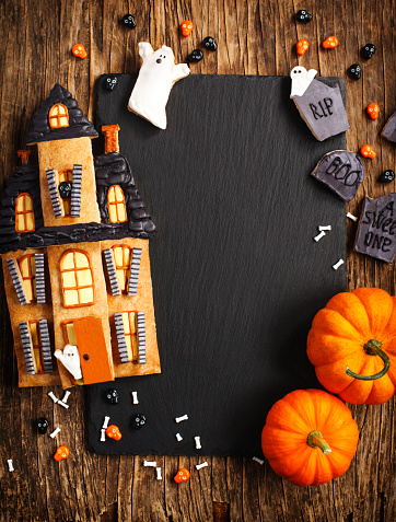 Halloween Background with cookie Haunted House and pumpkins - gettyimageskorea