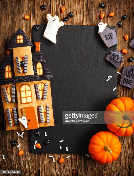 Halloween Background with cookie Haunted House and pumpkins