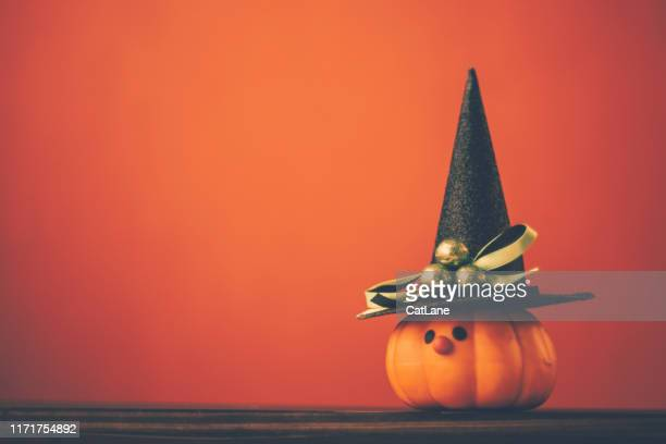 halloween background with cute pumpkin witch - happy halloween stock photos and pictures