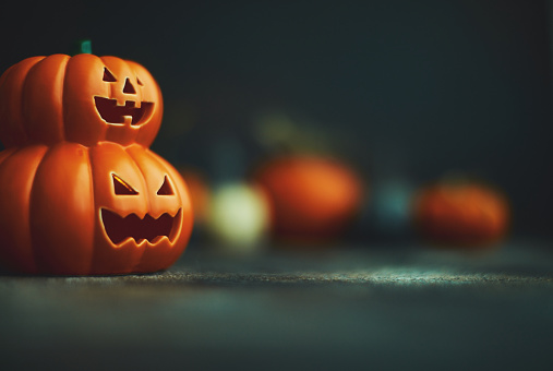Halloween background with Jack O'Lantern and pumpkins 1183244512