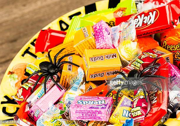 halloween candies in trick or treat bowl - halloween candy stock photos and pictures