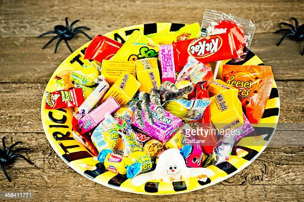 halloween candies in trick or treat bowl - bowl of candy stock photos and pictures
