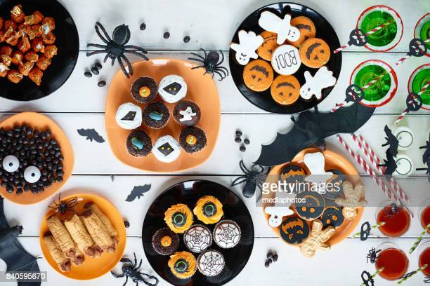 halloween candy bar - halloween party stock photos and pictures