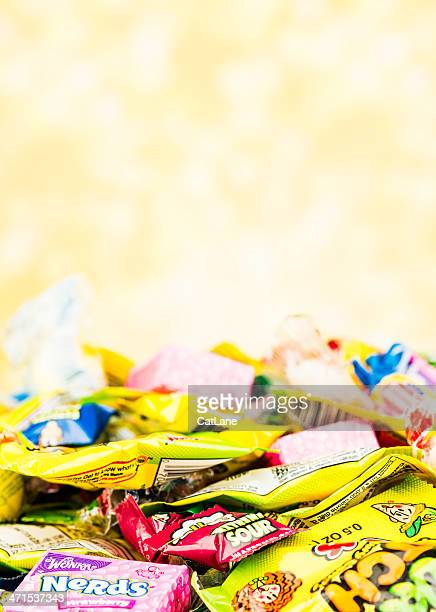 halloween candy - pile of candy stock photos and pictures