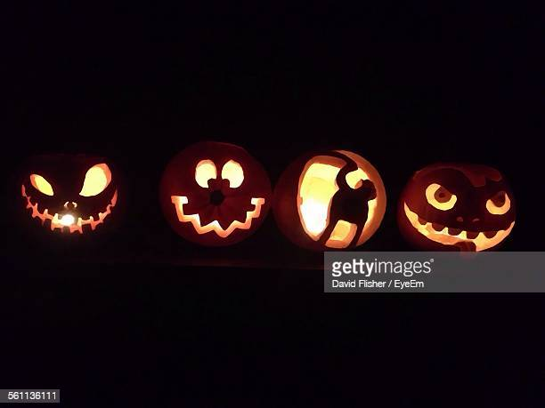 Halloween Carved Pumpkins Glowing In Dark