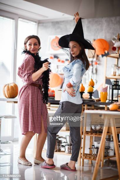 halloween celebration in kitchen with dancing and dressing up - mask dance stock pictures, royalty-free photos & images