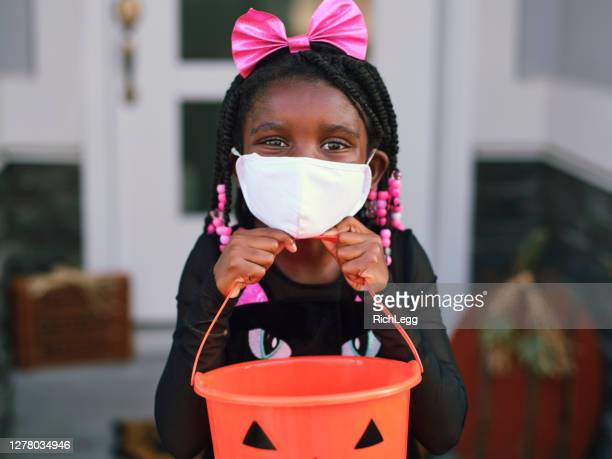 halloween children trick or treating wearing facemasks - trick or treat stock pictures, royalty-free photos & images