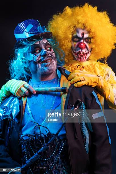 halloween clowns - zombie walk stock photos and pictures