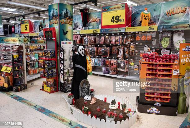 Halloween costumes and decorations are seen displayed at the French Carrefour supermarket in Spain