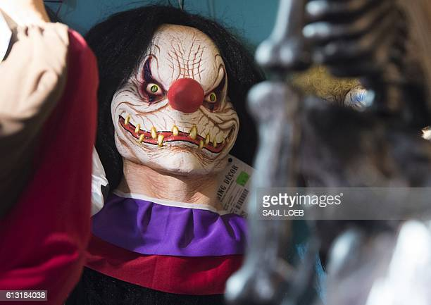 Halloween costumes and props including a 'scary' clown mask are seen for sale at Total Party a party store in Arlington Virginia October 7 2016 / AFP...
