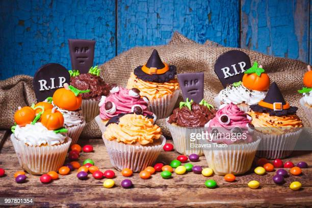 halloween cupcakes with colored mastic decorations - halloween party stock photos and pictures