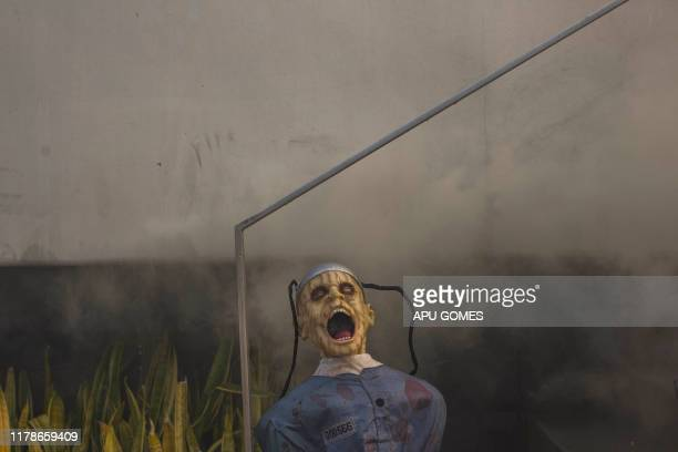 TOPSHOT Halloween decoration in a house on fire at N Tigertail Road in Crestwood Hills in Los Angeles California on October 28 2019 A wildfire broke...