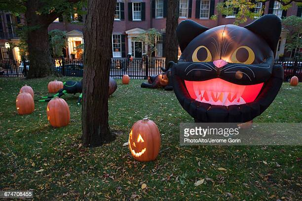 halloween decorations illuminated at twilight - halloween decoration stock pictures, royalty-free photos & images