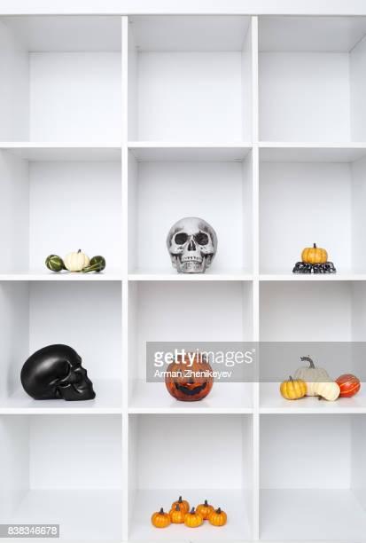 Halloween decorations in bookshelf