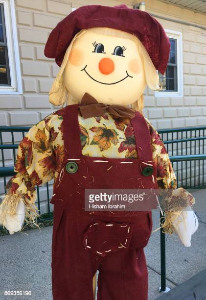 halloween decorations (friendly) scarecrow. - scarecrow faces stock photos and pictures