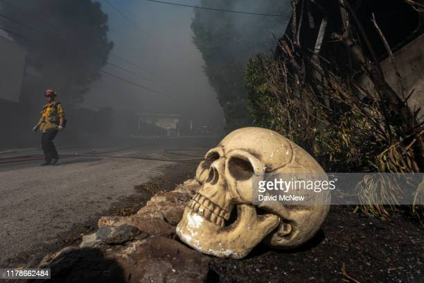 Halloween decorations sit out near the ruins of a house that burned in the Getty Fire on October 28 2019 in Los Angeles California Reported at 130 am...